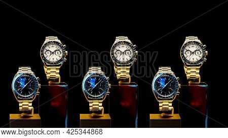 A Lot Of Elite Men's Wristwatches On A Black Background.