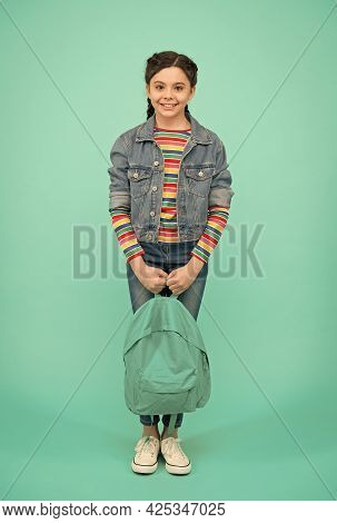 Be Fashionable. Fashion Look Of Little Child. Little Girl Hold Bag Blue Background. Fashion Accessor