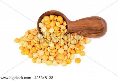 Dry Yellow Split Peas In Wooden Spoon, Isolated On White Background. Halves Of Yellow Legume Peas.