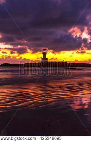 The Scenery Of The Silhouette Of Khao Lak Light Beacon In Sunset Time With The Dramatic Twilight Sky