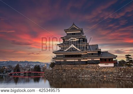 Old Castle In Japan. Matsumoto Castle Against Twilight Sky In Nagono City, Japan. Castle In Winter.