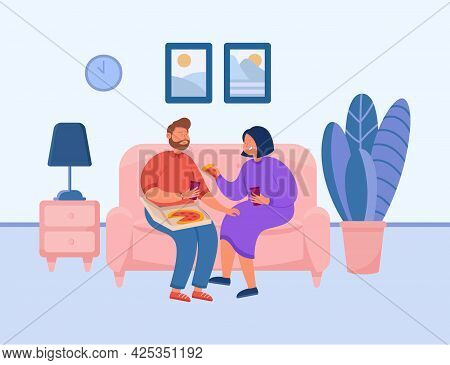 Cute Couple Eating Pizza On Couch. Boyfriend And Girlfriend On Sofa, Man And Woman Eating Together A