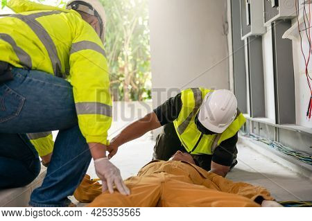 Safety Team Professional Help Technician Accident Electric Shock Unconscious In Site Work. Danger Wo