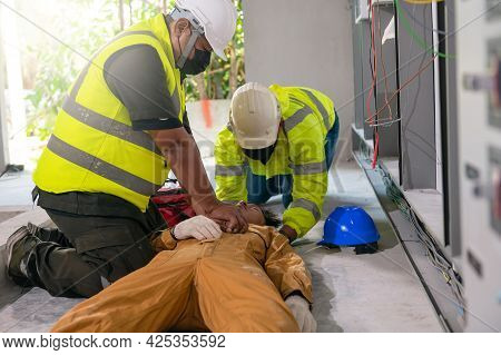 Safety Team Cpr For First Aid Employee Electrician Worker Accident Electric Shock Unconscious. Asian