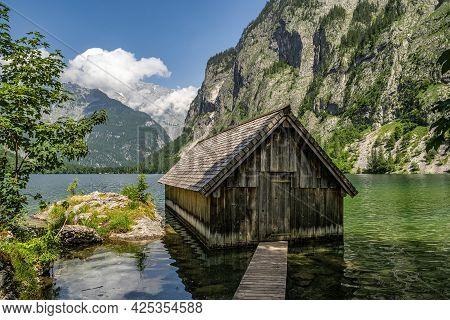 Boathouse At Obersee Lake Behind The Watzmann Massif, Salet At Koenigssee, Berchtesgaden National Pa