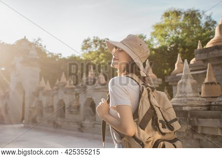 Asian Female Traveler Smile Wearing A Hat With Backpack In The Attraction Asia Culture Under Sunshin
