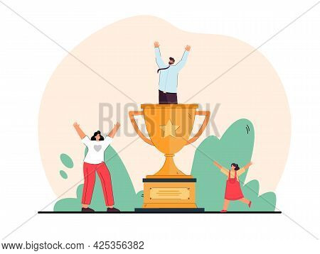 Happy Businessman Standing In Golden Cup. Wife And Daughter Rejoicing Over Victory Of Husband And Fa
