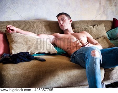 Muscular Young Male Bodybuilder Sleeping On Couch