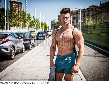 Handsome Muscular Shirtless Hunk Man Outdoor In City Setting