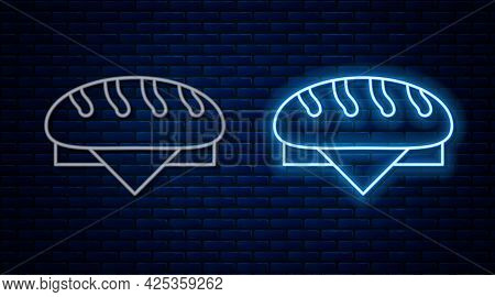 Glowing Neon Line Bread Loaf Icon Isolated On Brick Wall Background. Vector