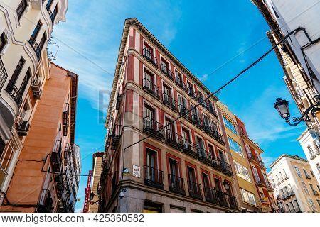 Madrid, Spain - May 8, 2021: Traditional Residential Buildings In Central Madrid. Postas Street