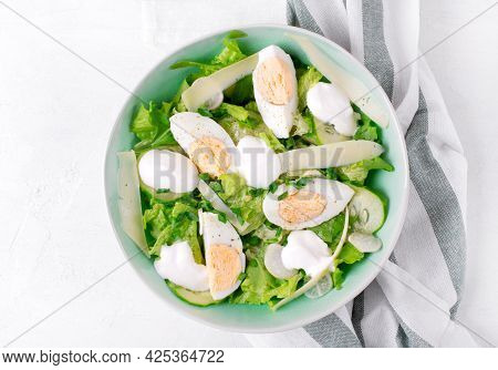 Salad With Eggs, Lettuce, Cheese, Cucumber, White Radish And Scallion Topped With Yogurt Served In T