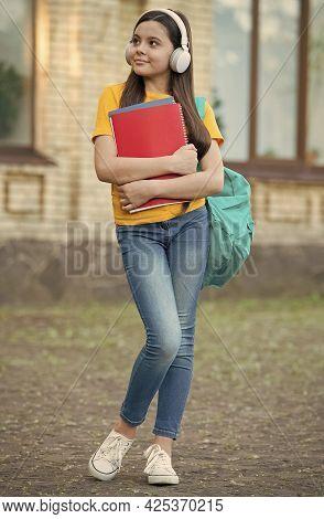Educational Technology. Happy Kid Wear Headphones Outdoors. English School. Modern Technology. Remot