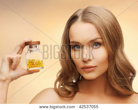 bright picture of beautiful woman with vitamins