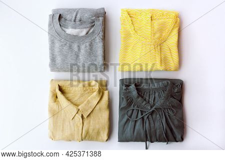 Neatly Arranged Womens Clothing In Gray And Yellow Colors