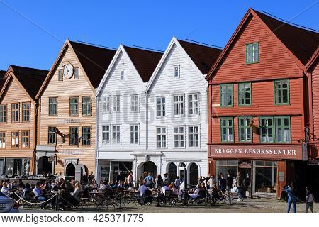 Bergen, Norway - July 23, 2020: People Visit Bryggen District Of Bergen, Norway. It Is A Unesco Worl