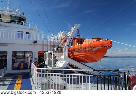 Bjornafjord, Norway - July 23, 2020: Lifeboat On A Car Ferry Crossing Bjornafjord In Norway. Public