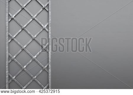 Forged Decorative Iron Fence. A Gray-blue Patterned Fence In An Architectural And Historical Place.