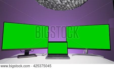 Three Computer Devices With Green Screens. Action. Several Computer Monitors With Green Chromakey Fo