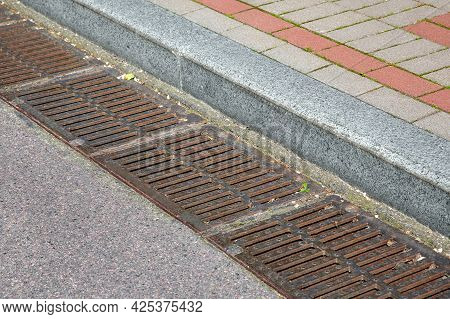 Rectangular Hatches Of The Lattice Of The Drainage System For Drainage Of Rainwater From The Road Su