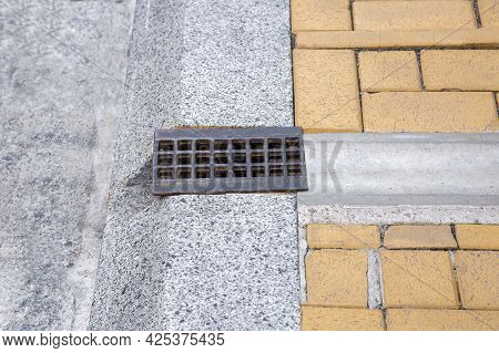 Drainage System Grate, Grill For Removal Of Stormwater From Walking Pavement Through Ditch And Hole