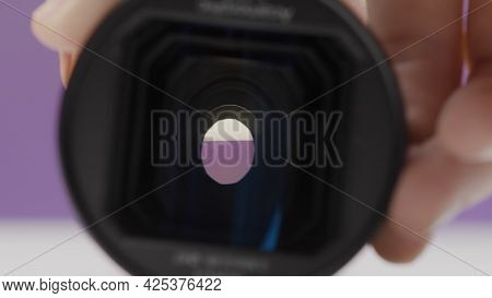 Photographer Adjusts Focus On Lens. Action. Professional Lens Settings On New Camera. Operation Of C