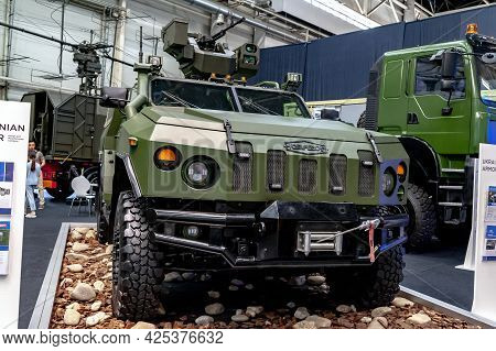 Military Armored Vehicle. Armored Car Novator With A Combat Module On Display At The International E