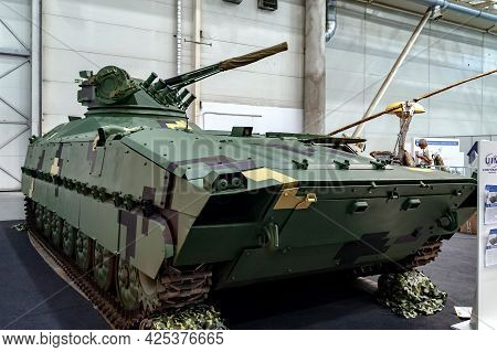 Infantry Fighting Vehicle. Tracked Armored Vehicle Tank With A Combat Cannon Module At The Internati