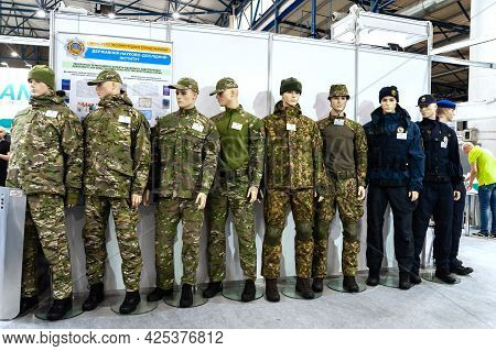 Military Uniform. Mannequins Dressed In Military Uniforms Of Various Troops At The International Exh