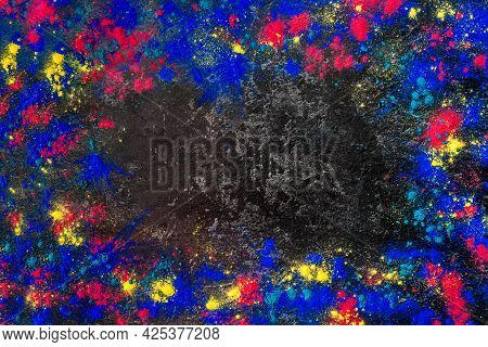 Top View Abstract Colorful Happy Holi Background. Color Vibrant Powder On Concrete. Colored Splash E