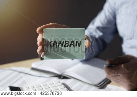 Kanban Word On Paper Note In Male Hand. Lean Method In Management Concept.