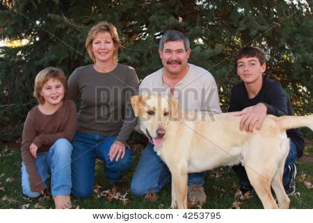 Family Outside With Their Dog
