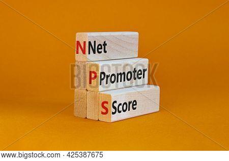 Nps Net Promoter Score Symbol. Wooden Blocks With Words 'nps Net Promoter Score'. Beautiful Orange B