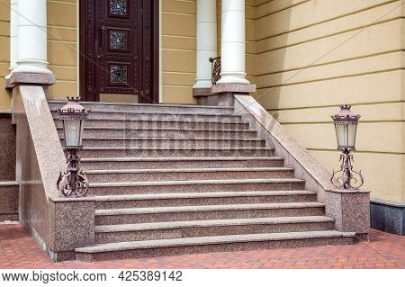 Granite Staircase With Iron Forged Retro Street Lighting Lanterns On The Threshold With Columns At T