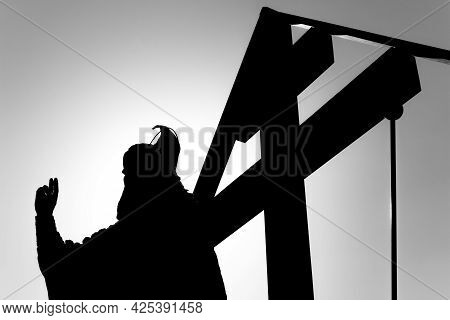The Silhouette Of The Monument To The Orthodox Old Believer Protopop Avvakum And The Cross Against T