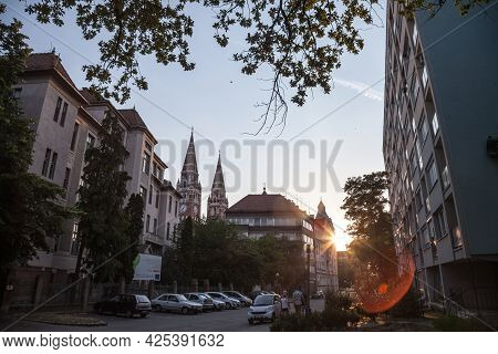 Szeged, Hungary - July 20, 2017: Szeged Cathedral Seen From The Bottom Iat Dusk From A Nearby City.