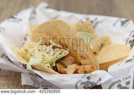 Bits And Pieces Of Fish Fillet Fills This Taco Along With The Cole Slaw.