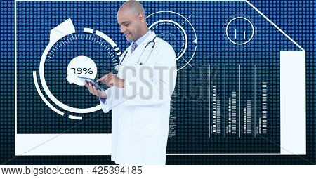 African american male doctor using digital tablet against medical data processing on blue background. medical research and science technology concept