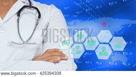 Mid section of female doctor against medical icons and world map on blue background. medical research and science technology concept