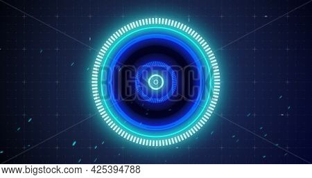 Image of glowing blue scope scanning and spinning with glitch on grid background. digital interface connection and communication concept digitally generated image.
