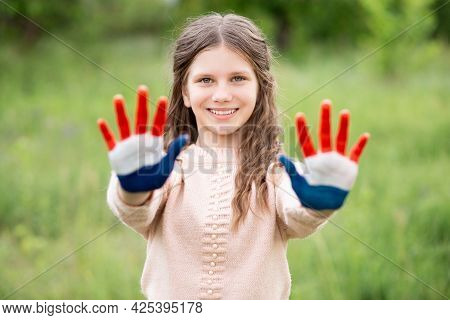 Croatia Flag Painted On Child Hands. Girl With Open Hands Raised. Patriotic Holiday. Independence Da