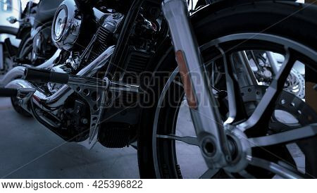 Selective Focus On Motorcycle Frame. Closeup Motorcycle Exhaust Pipe, Engine Guard, And Foot Rest. M
