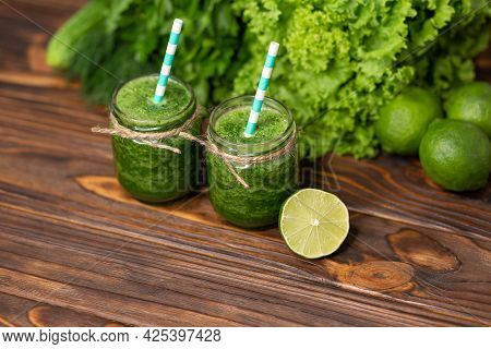 Freshly Blended Green Fruit Smoothie In Glass Jar With Straw. Bottles Of Aloe Vera Cocktail. Healthy