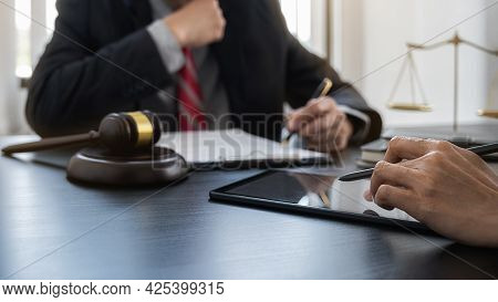 Professional Lawyer Advising A Client On Commercial Contract Legal In Service Office. Justice, Law,