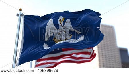 The Flags Of The Louisiana State And United States Of America Waving In The Wind. Democracy And Inde