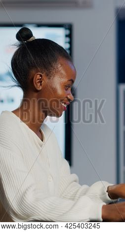 Black Freelancer Game Developer Typing On Keyboard Developing New Level Of Videogame. African Pro Pl