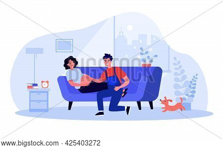 Happy Husband Touching Belly Of Pregnant Wife. Future Parents In Living Room, Woman Lying On Sofa Fl