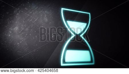 Image of glowing loading hourglass digital interface. global technology, communication and digital interface concept digitally generated image.