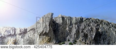 Banner With A Panorama Of The Crimean Mountains With A Clear Blue Sky And The Sun. The Nature Of Rus