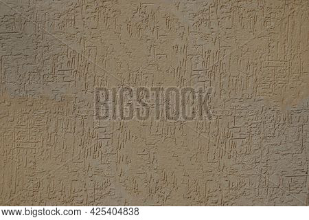 Beige And Brown Stucco Wall Plaster Texture - A Close-up Of A Plastered Wall